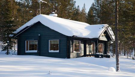 Ferienhaus im Winter von außen